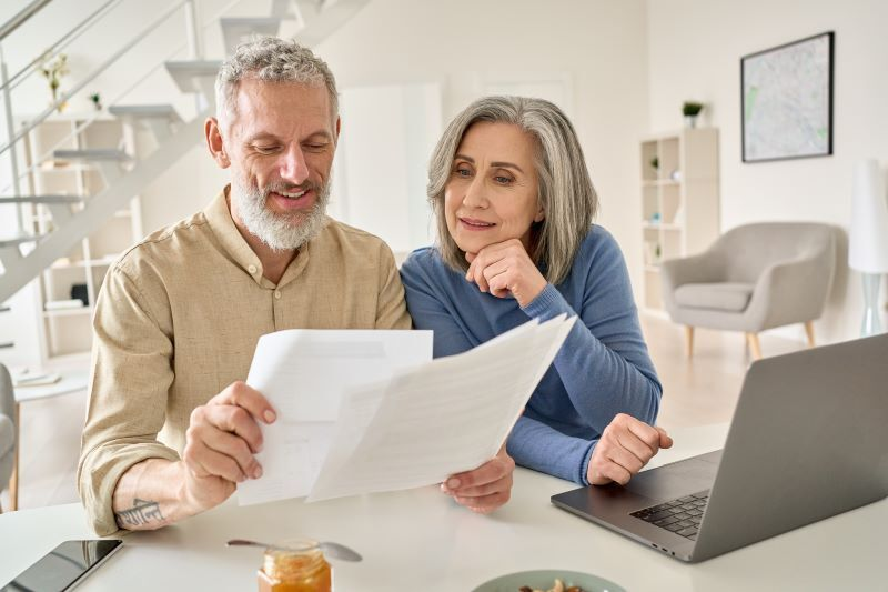 couple reviewing 401(k) and IRA