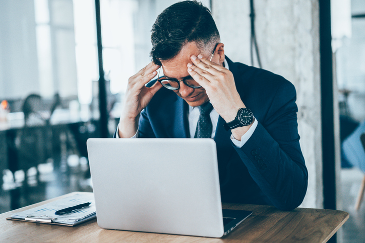 man at desk stressed about retirement