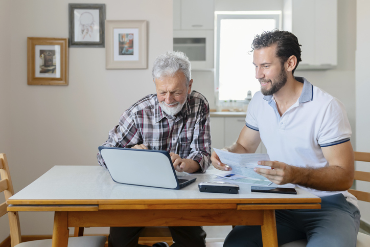 reviewing retirement plan with grandparent