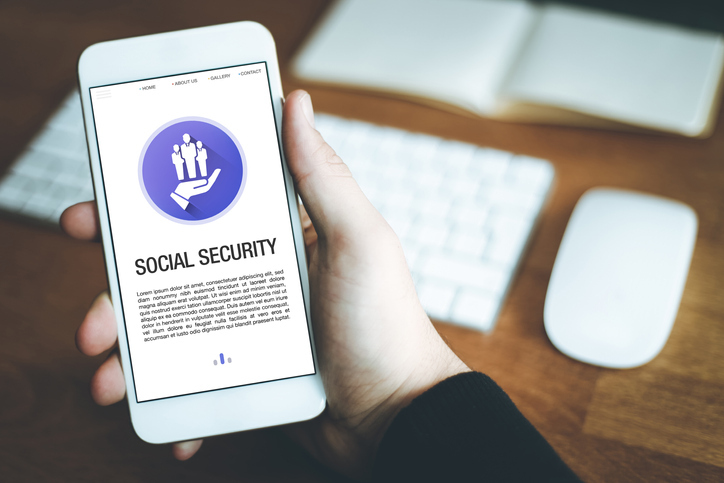 social security research on smartphone screen